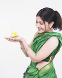 Asian woman with a yellow chick Royalty Free Stock Photography