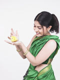 Asian woman with a yellow chick Stock Photography