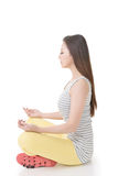 Asian woman in yoga pose Royalty Free Stock Image