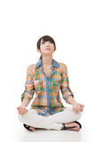 Asian woman in yoga pose Royalty Free Stock Photography