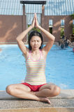 Asian woman in Yoga position Royalty Free Stock Images