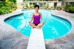 Asian Woman and Zen Moment at the Pool Royalty Free Stock Images