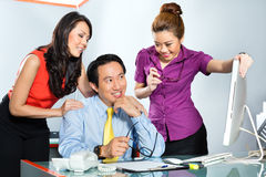 Asian Womanizer boss flirting at the office Stock Photography