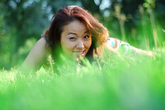 Asian womanl in a field Stock Photos