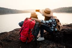 Asian women backpack on the park journey and traveling on holiday stock images