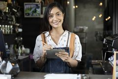 Free Asian Women Barista Smiling And Using Coffee Machine In Coffee S Stock Photos - 129808853