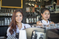 Asian women Barista smiling and using coffee machine in coffee s. Hop counter - Working women small business owner food and drink cafe concept Stock Photo