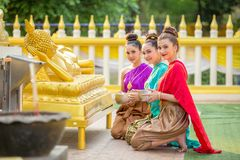Asian woman are bathing Buddha statue happily in thailand. Asian women are bathing Buddha statue happily in thailand royalty free stock photos