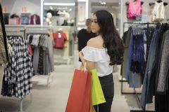 Asian women and Beautiful girl is holding shopping bags smiling Royalty Free Stock Photos