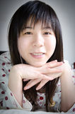 Asian women on bed. Asian woman smile portrait on bed Stock Images