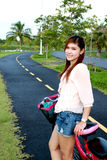 Asian women and bicycle on the road Stock Image