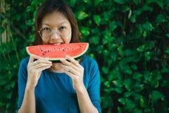Asian Women biting Slice Of Watermelon.  royalty free stock photo