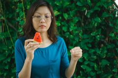 Asian Women biting Slice Of Watermelon. With green background royalty free stock photography