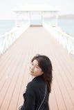 Asian women black jacket Royalty Free Stock Photos