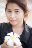 Asian women black shirt. Holding white flower. Stock Photos