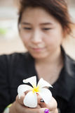 Asian women black shirt. Holding white flower. Royalty Free Stock Image