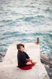 Asian women black shirt. Sitting on the sidewalk. Royalty Free Stock Photo