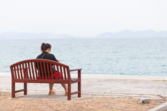 Asian women black shirt. Sitting on wooden bench. Stock Photo