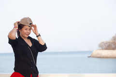 Asian women black shirt. She was wearing a hat Royalty Free Stock Photo