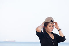 Asian women black shirt. She was wearing a hat Royalty Free Stock Photography