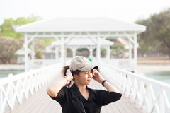 Asian women black shirt. She is wearing a hat Royalty Free Stock Images