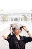 Asian women black shirt. She is wearing a hat Stock Photos