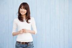 Asian women blue background Stock Photo
