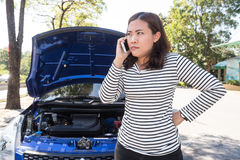 Asian women calling for assistance after breaking down car Stock Photos