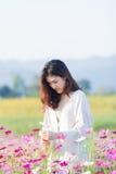 Asian women at cosmos garden. Asian beautiful woman at cosmos garden Royalty Free Stock Photography