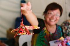 Asian women displaying her Chinese Paper Lantern Royalty Free Stock Photo