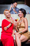 Asian women drinking cocktails in bar Stock Image