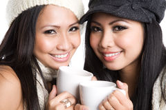 Asian women drinking coffee royalty free stock images