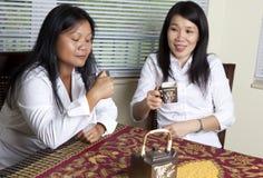Asian women drinking tea Royalty Free Stock Photo