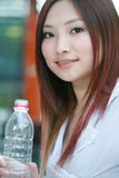 Asian women drinking water Royalty Free Stock Images