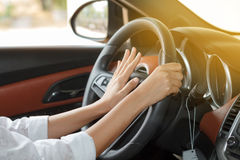 Asian women are driving cars on the road and squeeze klaxon.soft Stock Image