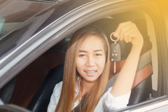 Asian women are driving cars on the road. Asian woman are driving cars the road Royalty Free Stock Images