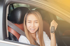 Asian women are driving cars on the road. Asian woman are driving cars the road Royalty Free Stock Image
