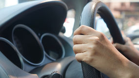 An asian women driving a low class car. Body parts (hands) driving a car Royalty Free Stock Photo
