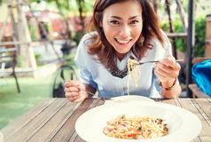 Asian women eating delicious,. Asian woman eating delicious,Focus on face Royalty Free Stock Image