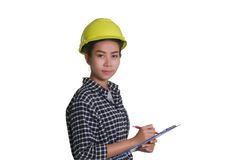 Asian women engineers and technicians are checking the list on t. Asian woman engineers and technicians are checking the list on the board isolated on white Stock Image
