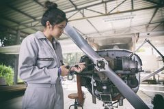 Asian women Engineers and technicians are repairing aircraft. Asian woman Engineers and technicians are repairing aircraft royalty free stock photo