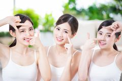 Asian women smile happily. Asian women eye care and making frame with hands stock photography