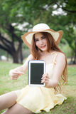 Asian women filed tablet and pointing to the tablet. Stock Photo