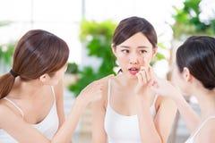 Asian women worry her skin royalty free stock photos