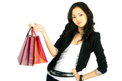 Asian women with gift bags, isolated. Asian young woman with shopping bags, isolated on white Stock Photo