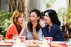 Asian women gossiping about things Royalty Free Stock Photo