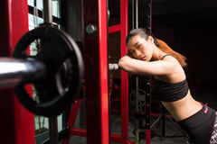 Asian women at gym.Fitness girl training in fitness center. Asian woman resting after squat exercises in gym, fitness woman at fitness center Stock Images