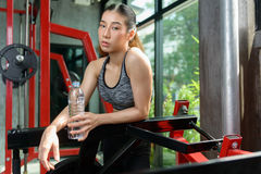 Asian women at gym.Fitness girl training in fitness center. Royalty Free Stock Photos