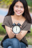 Asian women hand hold show retro clock times at 6 o`clock. Asian woman hand hold show retro clock times at 6 o`clock, It`s time to do something concept Royalty Free Stock Photo
