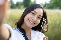 Asian women happy smile taking photos and Selfie on relaxing ti stock photography